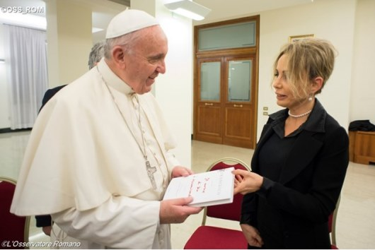 "Pope Francis receives the book ""The Name of God is Mercy"" from Marina Berlusconi, the President of the Mondadori Group, on Monday evening in the Casa Santa Marta"