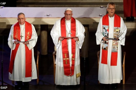Pope Francis, flanked by the president and secretary general of the Lutheran World Federation, lead a joint commemoration of the Reformation in October 2016 - AP