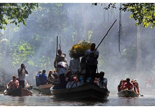 Pilgrims carry a statue of Our Lady to communities along the Amazon river - REUTERS