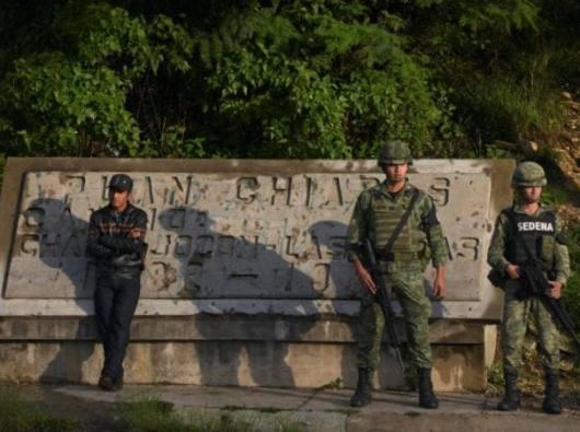 Garda Nasional berjaga-jaga di sebuah pos pemeriksaan di Negara Bagian Chiapas, Meksiko, 16 Juni 2019. Seorang  katekis ditembak mati  15 Juni di kapel Immaculate Conception di Acacoyagua, sekitar 75 mil dari perbatasan dengan Guatemala. (Kredit: Isabel Mateos / Reuters via CNS.)
